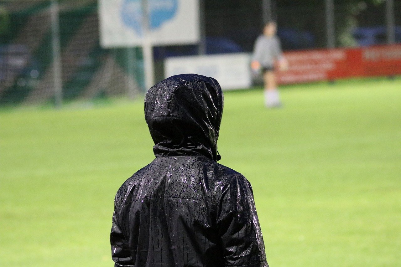 A football coach on the touchline at a training ground